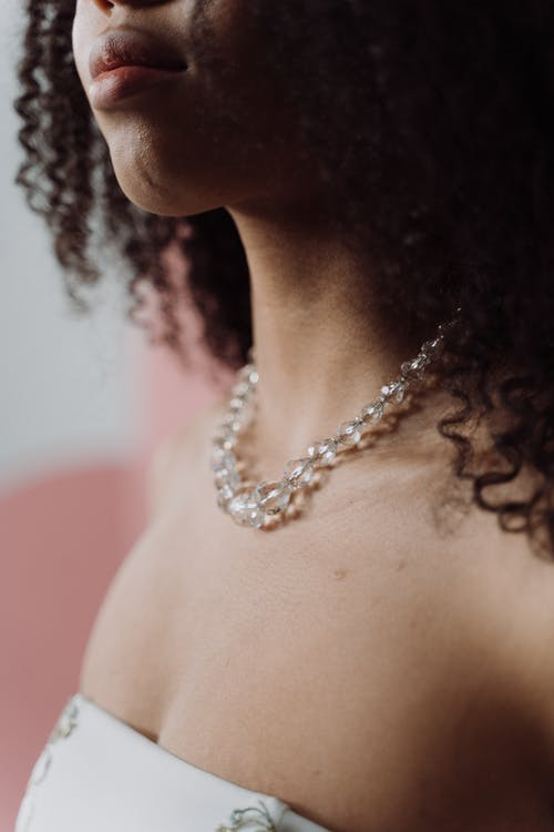 Woman Wearing Silver Chain Necklace