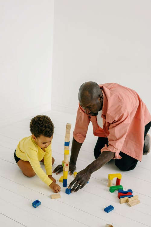 A Father Playing Wooden Blocks with His Son