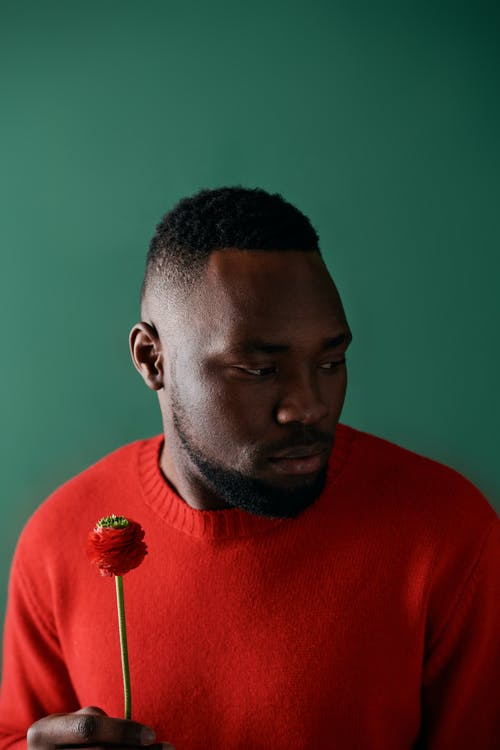 A Bearded Man Wearing a Red Sweater