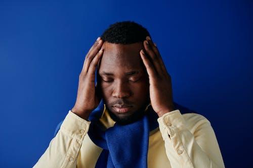 A Man Holding His Head