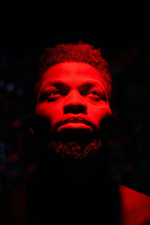 Mans Face With Red Light