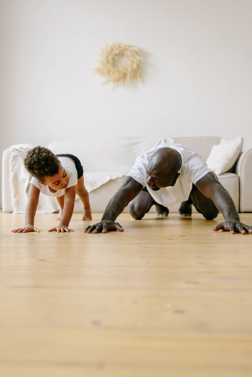 A Father and Son Exercising