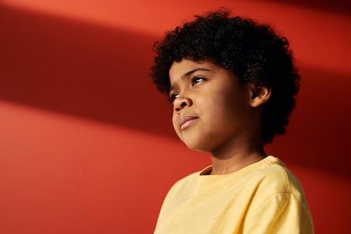 Child in Yellow Crew Neck Shirt