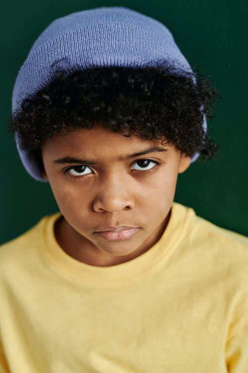 Boy in Blue Bonnet with Curly Hair