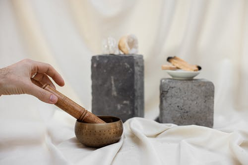 Person Holding Singing Bowl