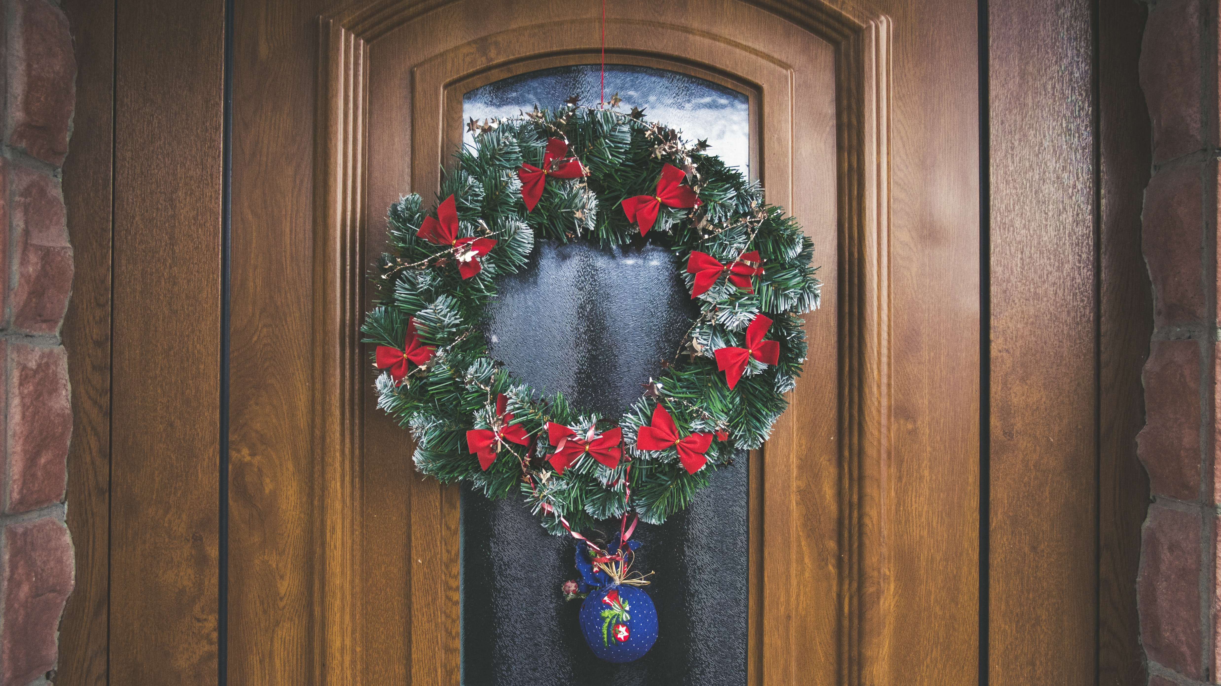 Green And Red Christmas Wreath On Door Free Stock Photo