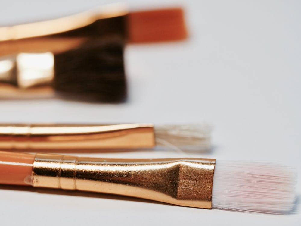 Selective Focus Photography of Brown Makeup Brush Kit