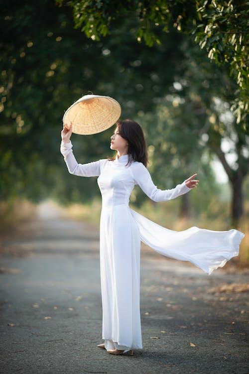 A Woman Wearing a Long White Dress