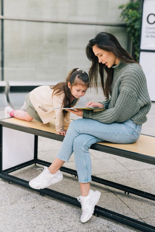 A Mother Reading a Book with Her Daughter