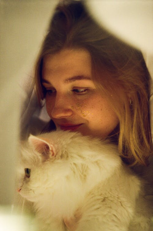 A Woman with Her White Cat