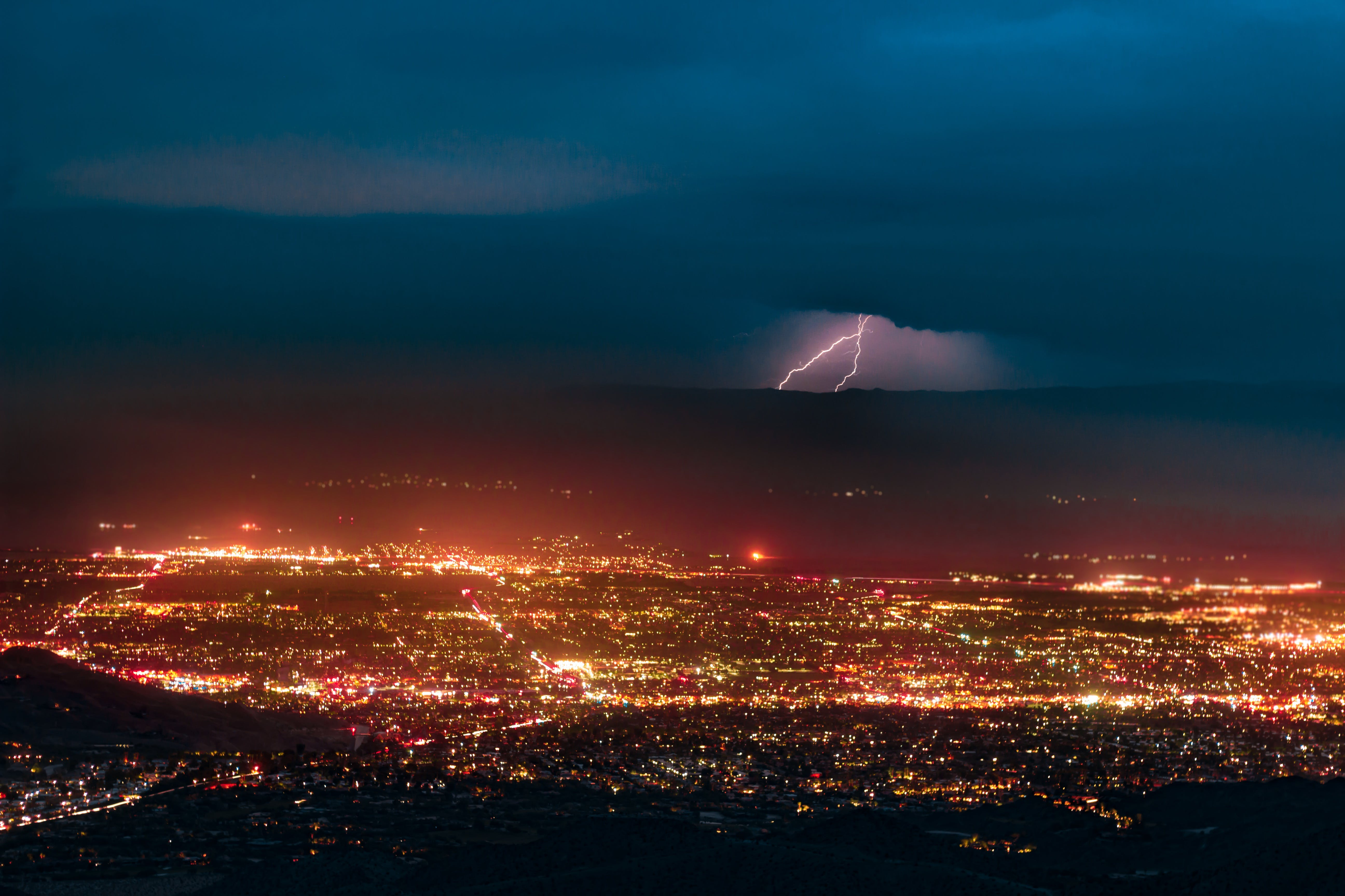 Aerial Photography of Urban City Overlooking Lightning during Nighttime