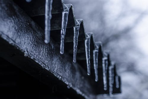 Close-up Photography of Ice Crystals on Edges of Corrugated Sheets
