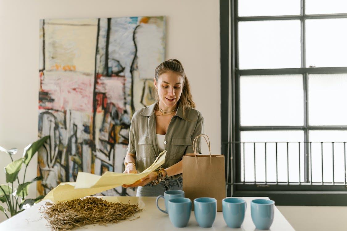 A Woman Packing Mugs