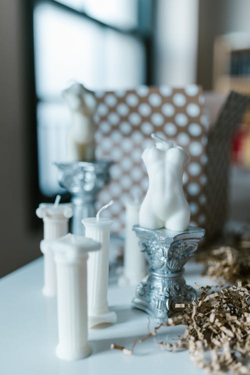 Clear Glass Candle Holder on White Table