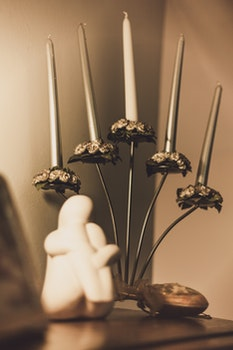 Gray Floral Candelabra on Brown Wooden Surface