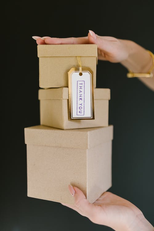 Person Holding Brown Wooden Box
