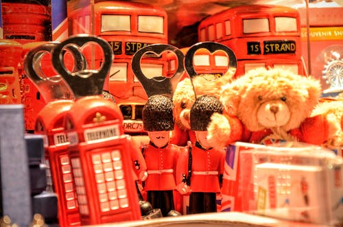 Brown Teddy Bear Near Red Miniature Telephone Booth