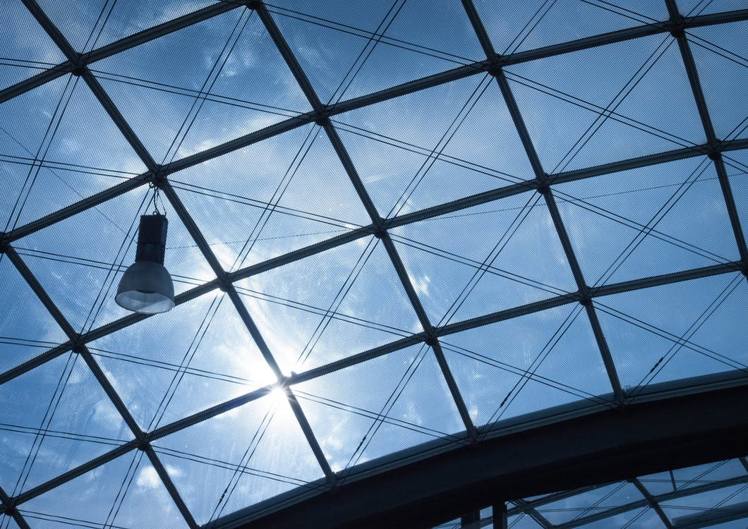 Photo of Black Frame Glass Ceiling during Daytime