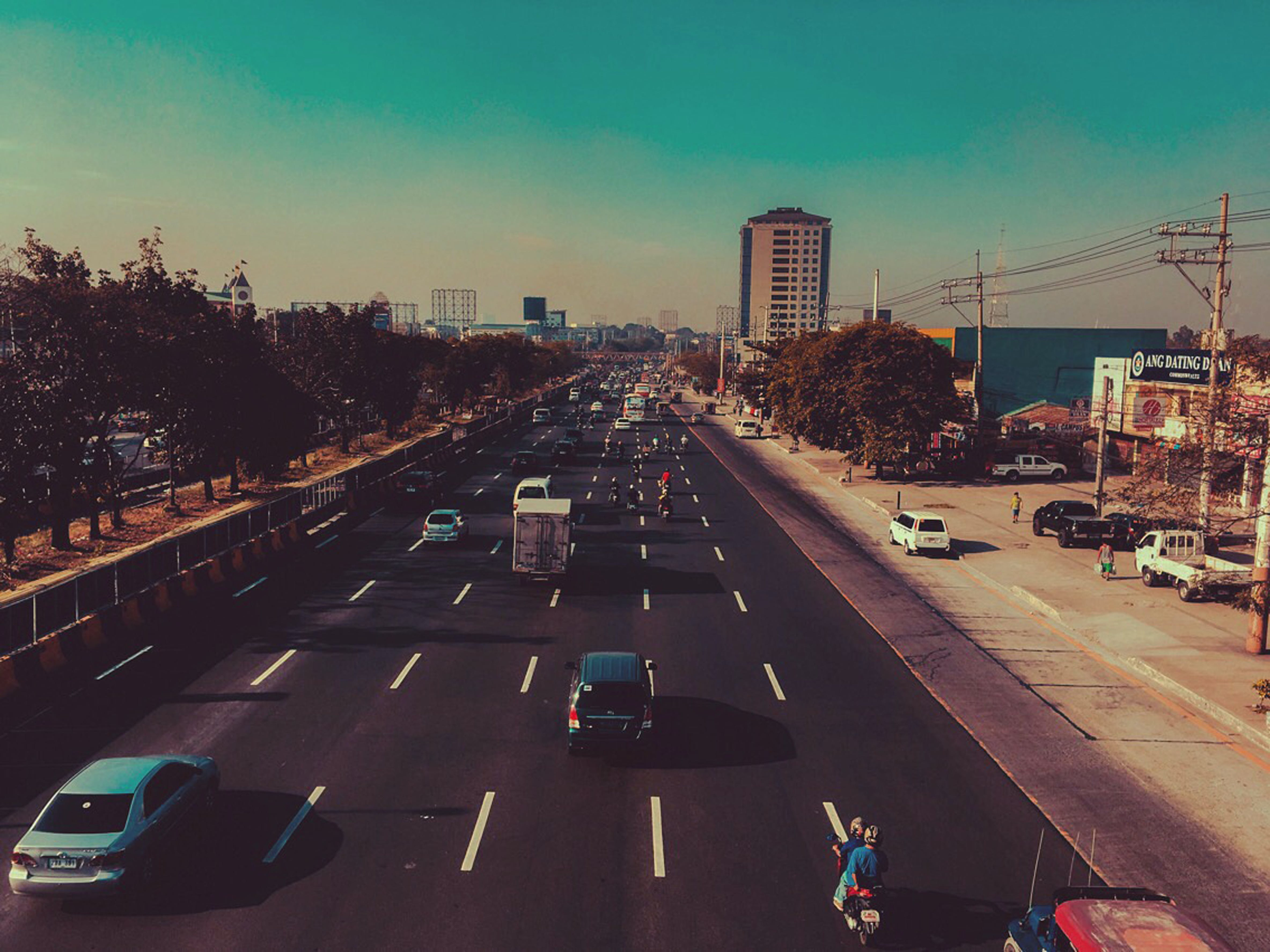 Cars in Black Concrete Road in Landscape Photography