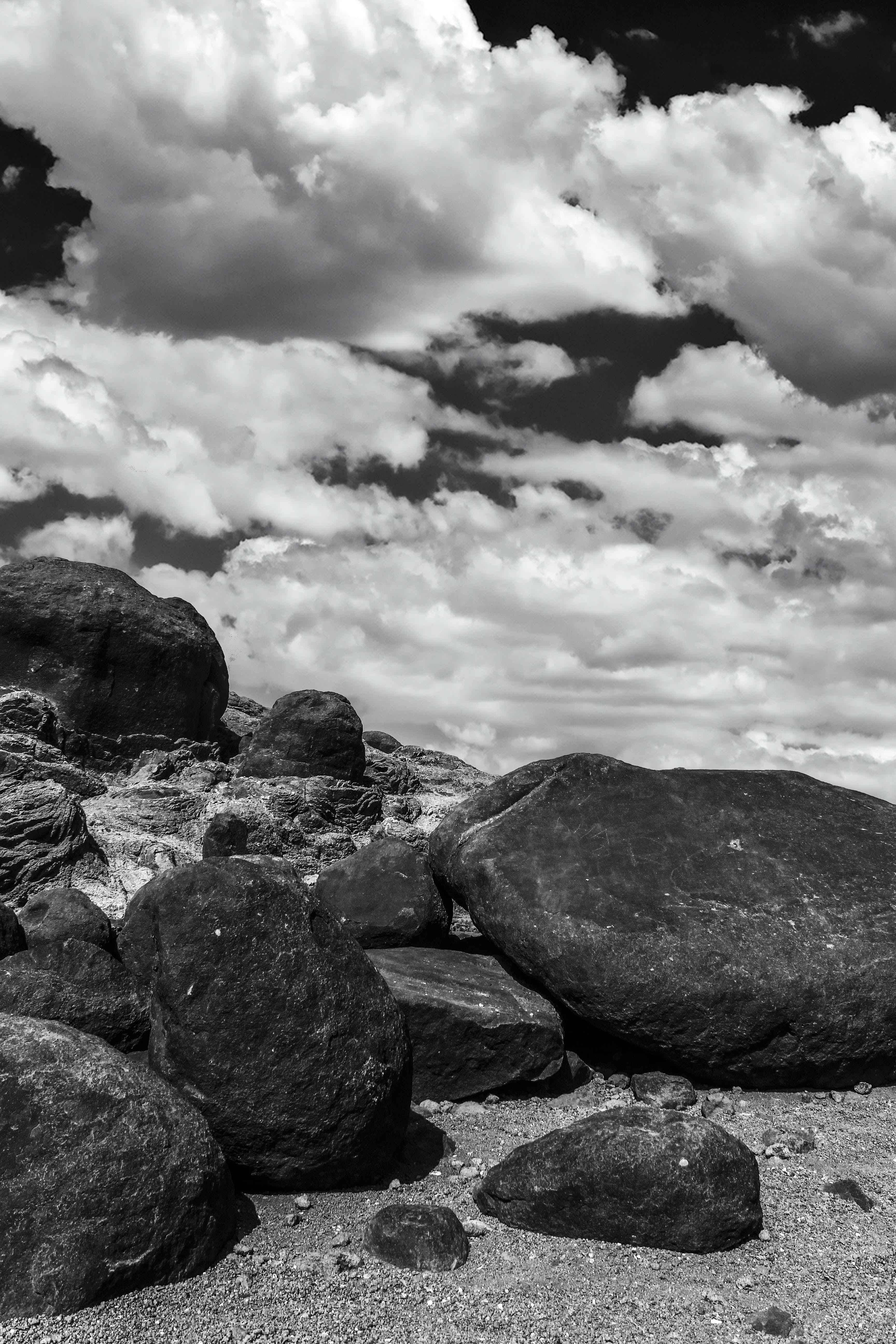 Gray Scale Photo Rocks and Clouds
