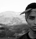 Grayscale Photography of Man Wearing Bandana