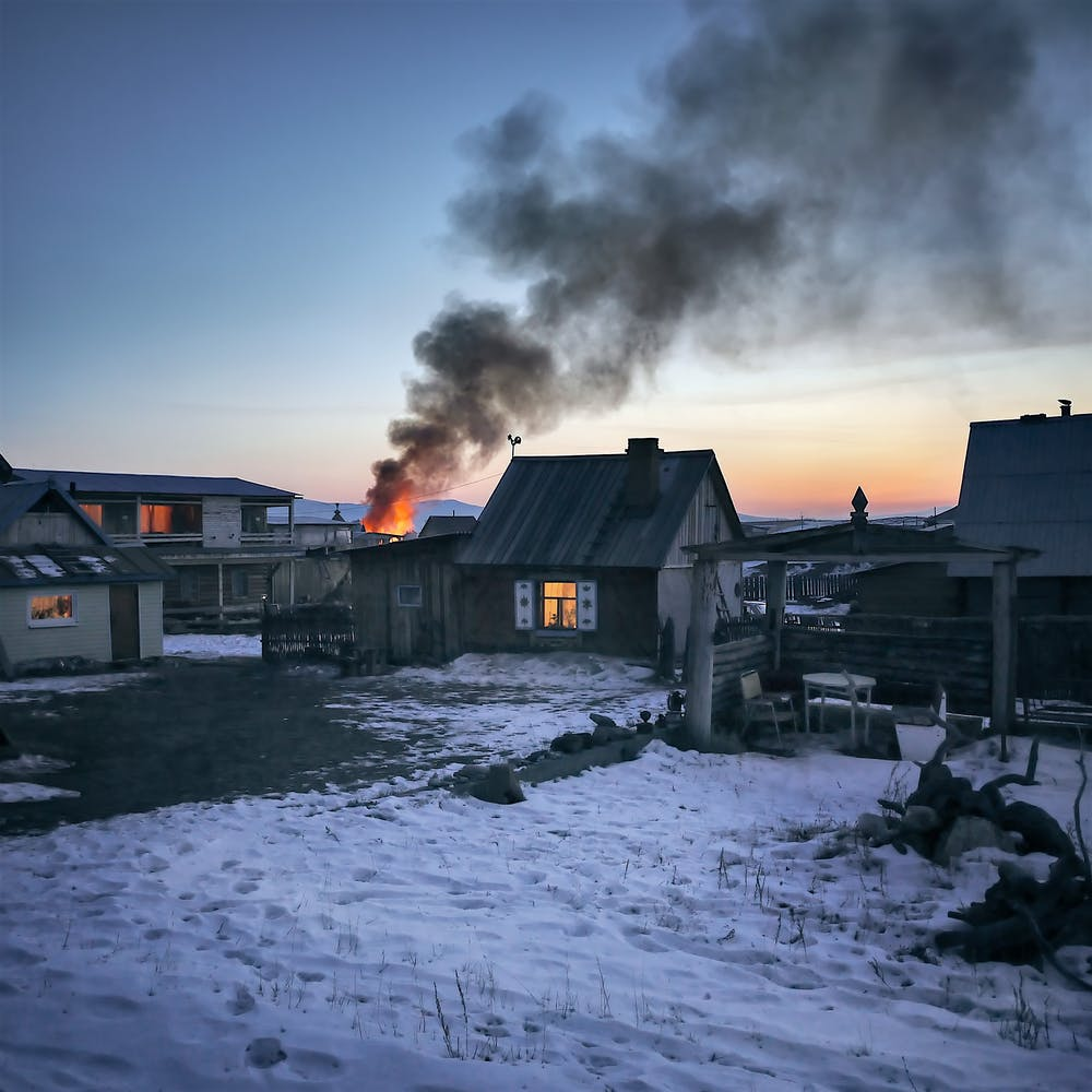 An old wooden house is burning.   Photo: Pexels