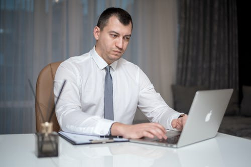 Man in White Dress Shirt Using Macbook