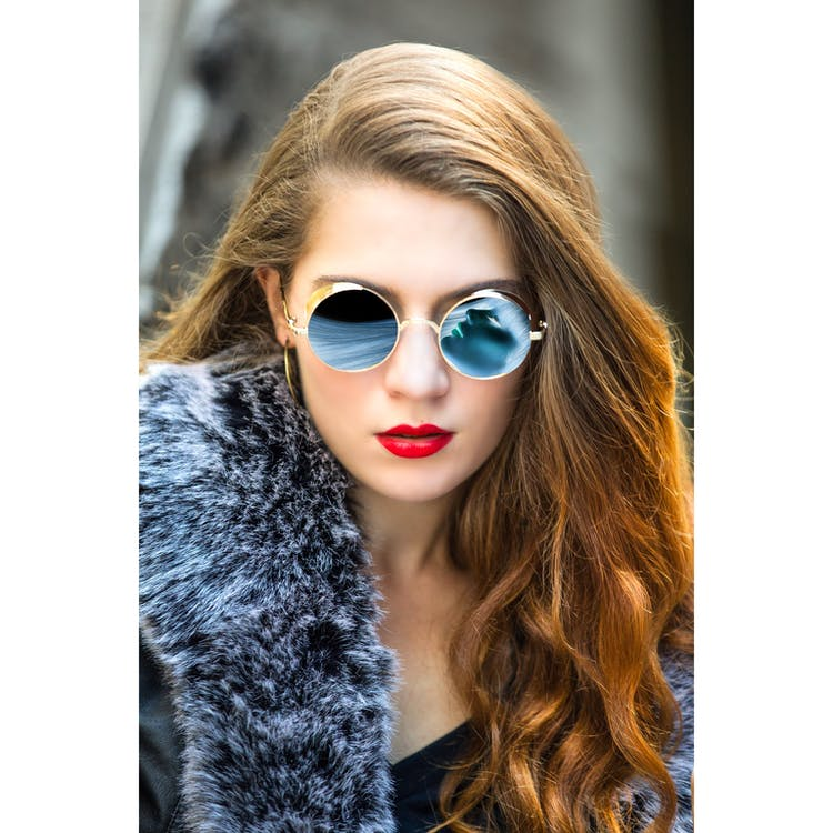 Woman Taking Selfie Wearing Round Blue Sunglasses