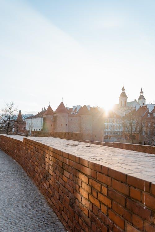 Red Brick Wall Near A Town