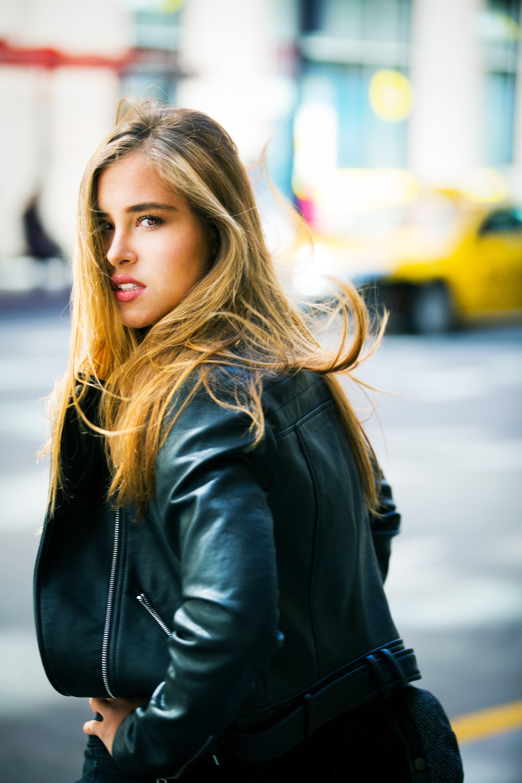 Woman Wearing Black Leather Jacket Facing Backward