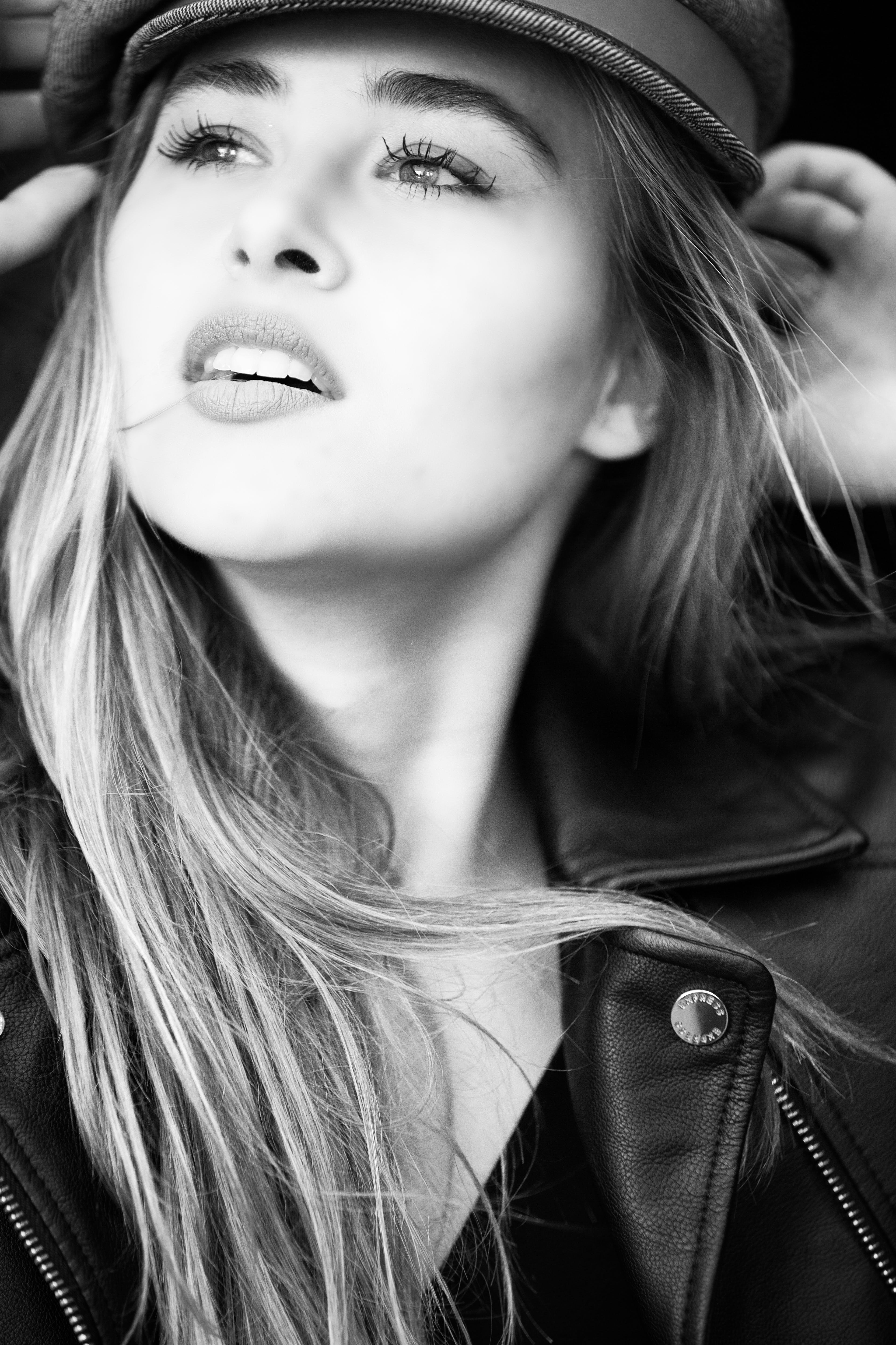Grayscale Photography of Woman Wears Leather Jacket and Cap