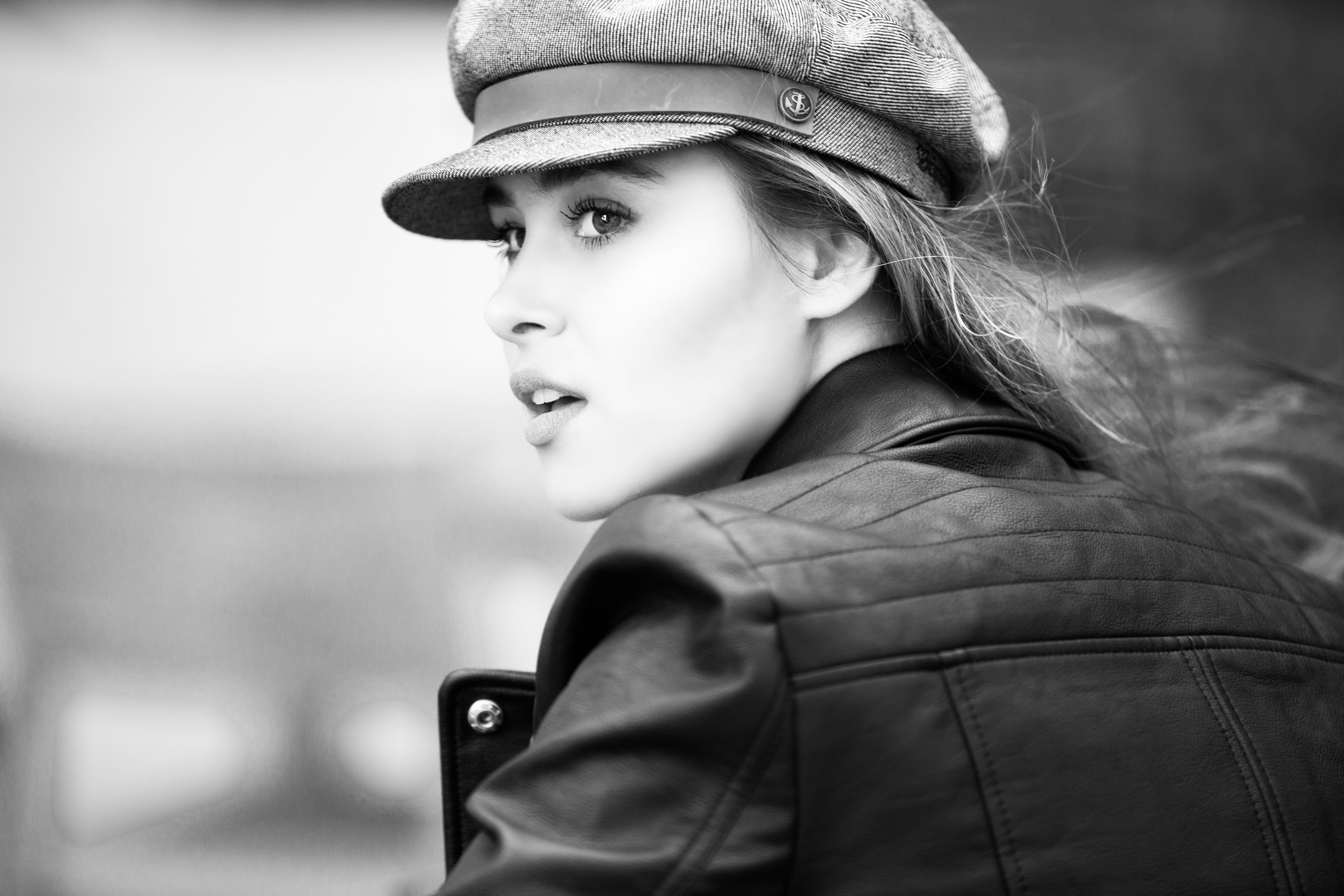 Grayscale photo of woman in black leather jacket · free stock photo