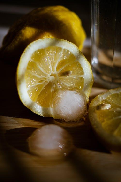 Sliced Lemon Beside the Ice Cubes