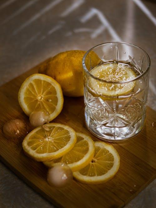 Slices of Lemon Beside the Drinking Glass