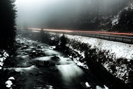 Time Lapse Photo of River Beside Highway during Cloudy Weather