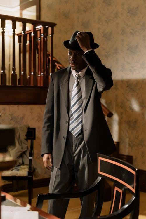 Photo of Man in Black Suit