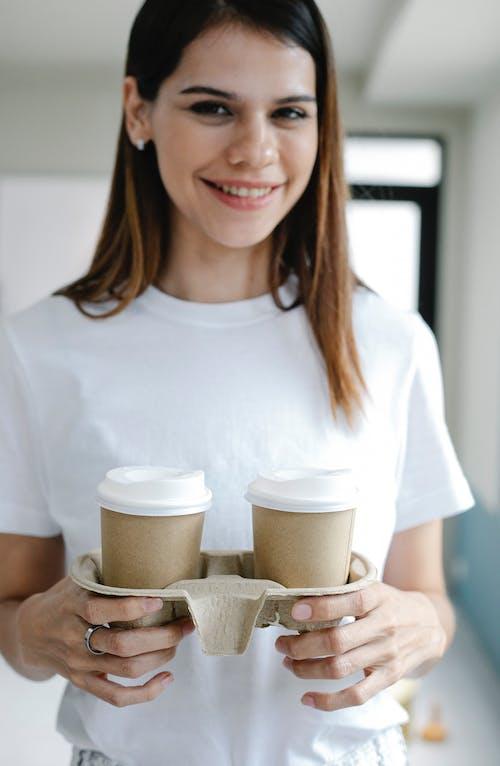 Optimistic female during coffee break