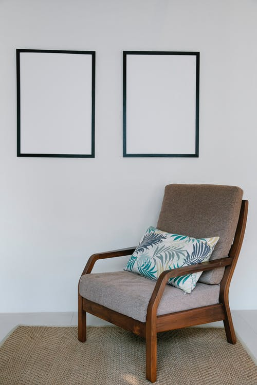 Brown Wooden Framed White and Black Padded Armchair