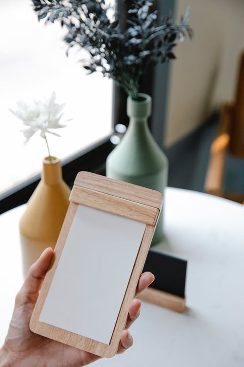 Woman with clipboard with blank paper