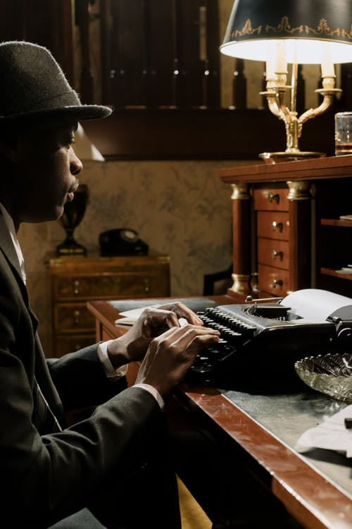 Photo of Invesitigator Working on a Case