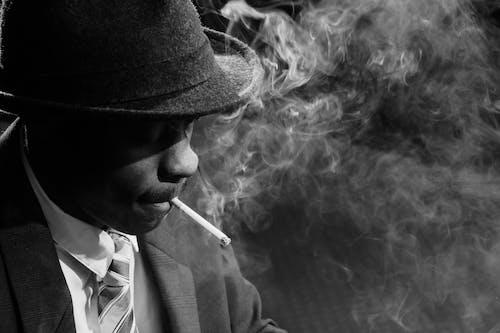 Close-Up Photo of Man Smoking Cigarette