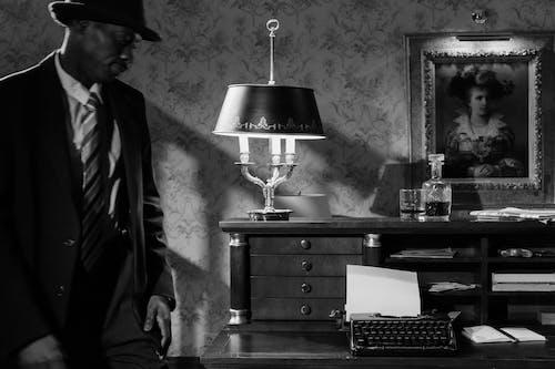 Photo of Invesitigator Walking Towards the Typewriter