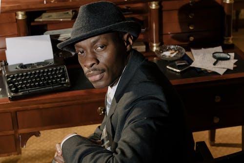 Phot of Man Wearing Black Fedora Hat