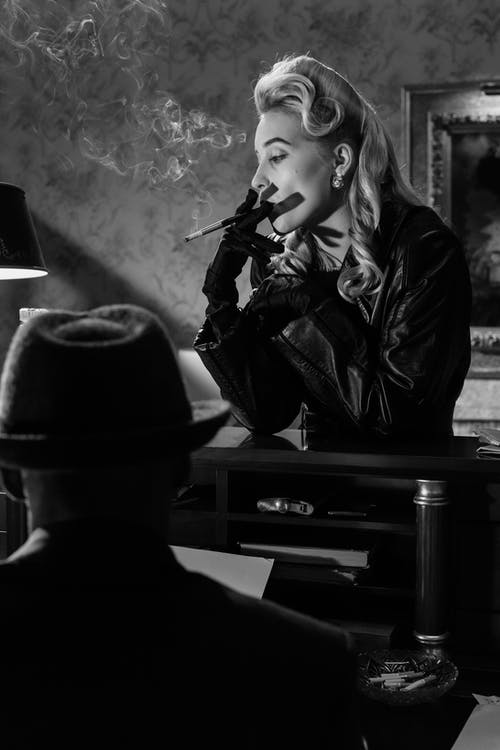 Photo of Woman Smoking on Counter Top