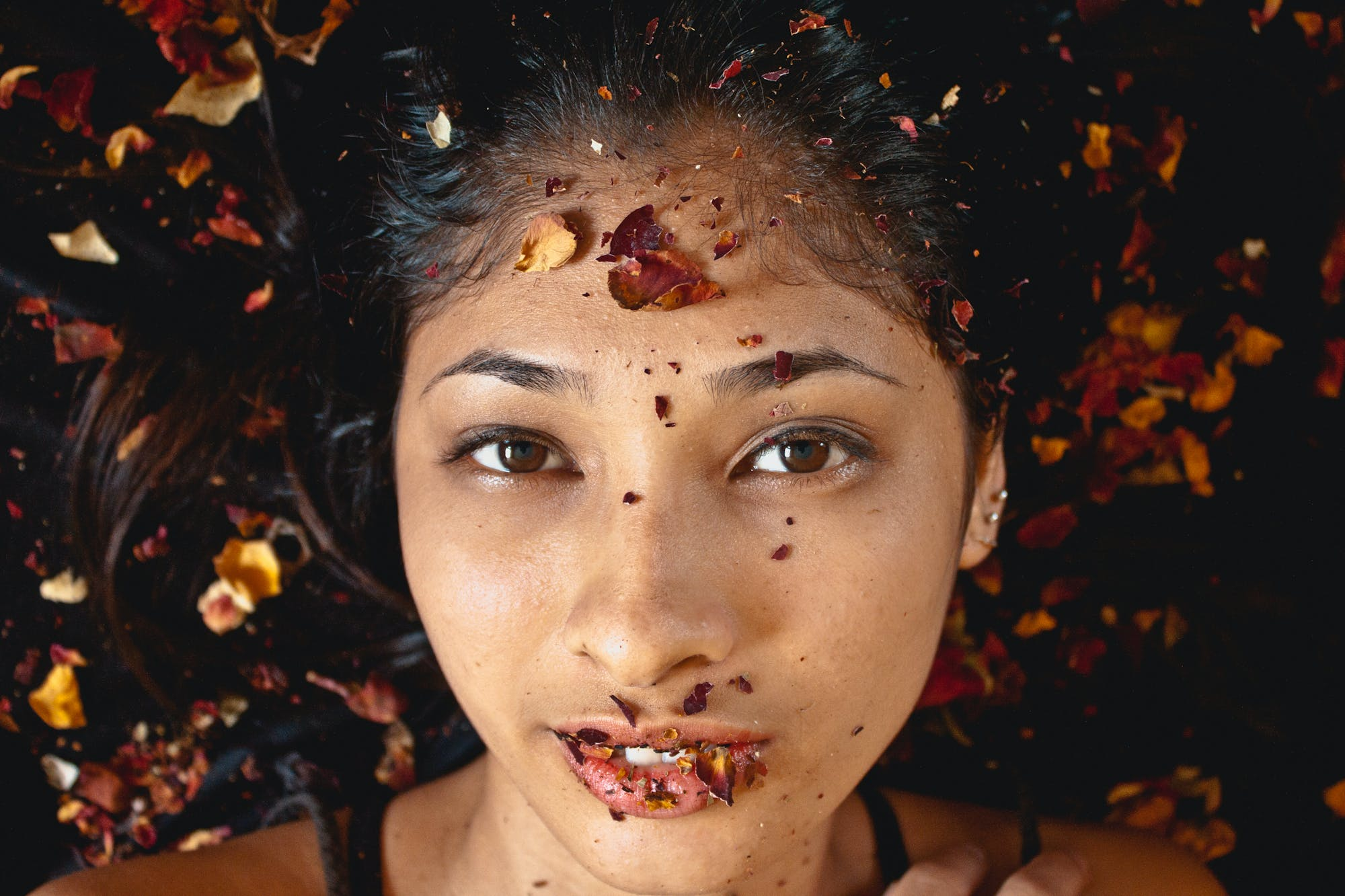 Photography of Woman Whose Lying on Dried Leaves