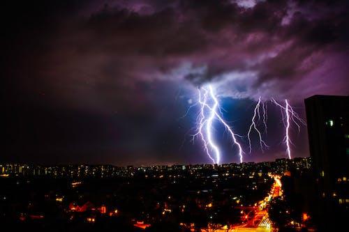 Skyline Photography of Lightning Strike during Nighttime