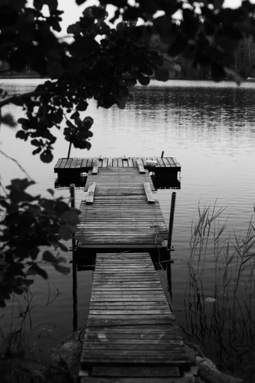 Grayscale Photo of Wooden Dock