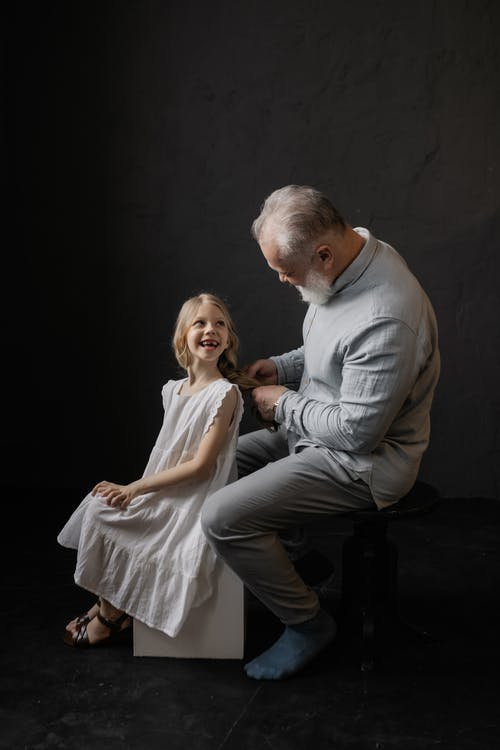 Grandfather and Granddaughter Smiling