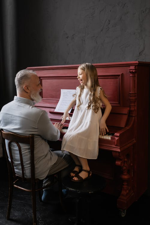 Grandfather and Granddaughter Laughing while Looking at Each Other