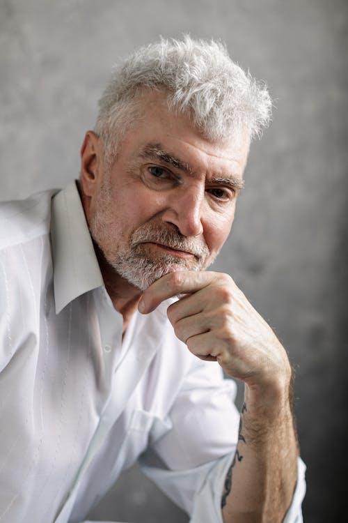 Elderly Man in White Dress Shirt